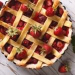 Strawberry cake close up in baking dish, horizontal top view — Stock Photo #75681515