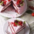 Sliced pink cake with fresh berries close up. vertical top view — Stock Photo #76681253