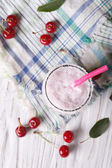 Milkshake cherry in a glass. vertical top view — Stock Photo