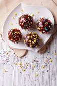 Chocolate apples with sprinkles candy. vertical top view — Stock Photo