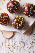 Chocolate apples with sprinkles candy close up vertical top view — Stock Photo