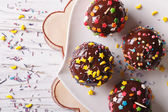 Chocolate apples with sprinkles candy close up horizontal top vi — Stock Photo
