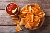 Nachos corn chips with spicy sauce. Horizontal top view — Stock Photo