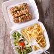 Fast food: kebabs, fries and fresh salad in the tray. vertical t — Stock Photo #80146994