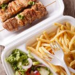 Street food: kebabs, fries and salad in tray close-up. vertical — Stock Photo #80147208