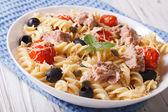 Fusilli pasta with tuna, parmesan and tomatoes in a bowl. horizo — Stock Photo