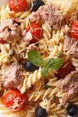 Fusilli pasta with tuna and tomatoes macro. background vertical — Stock Photo
