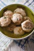Bread dumplings with broth, close-up  on the table. vertical top — Stock Photo
