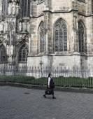 Christian non walking near the church — Stock Photo