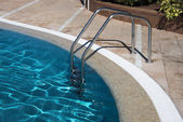 Staircase in water swiming pool — Stock Photo