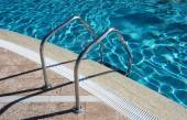 Staircase in swimming pool — Stock Photo