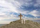 People looking at the holy cross with clouds and sea as backgrou — Stock Photo