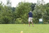Man playing golf on golftrack — Stock Photo