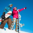 Girl and boy with snowboards on the snow — Stock Photo #56312465