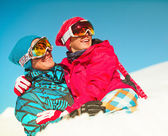 Girl and boy in winter clothes playing with sno — Stock Photo