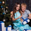 Young couple with christmas present — Stock Photo #60297709