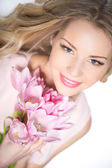 Woman with tulip bouquet — Stock Photo