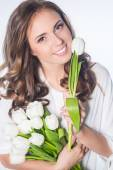 Woman with pulip flowers — Stock Photo
