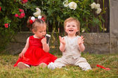 Children playing with cellphone — Stock Photo