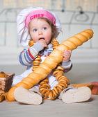 Little boy in bakery — Stock Photo