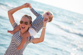 Mother with daughter on the beach — Stock Photo
