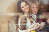 Young couple in caffe — Stock Photo