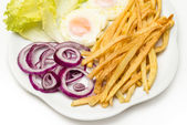 Fried eggs and various vegetables — Stock Photo