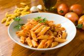 Mezze penne with pork meat and tomato sauce — Stock Photo