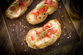 Italian bruschette with tomato and cheese — Stock Photo