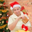 Grandmother with christmas gifts — Stock Photo #59908163