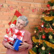 Grandmother with gifts — Stock Photo #59908431