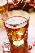 Whiskey in glass tumbler — Stock Photo