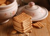 Pile of cookies on the wooden table — Stock Photo