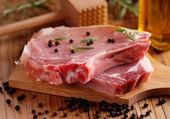 Pork ribs on cutting board — Stock Photo