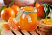 Tangerine jam in glass jar — Stock Photo
