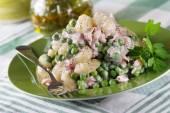 Potato gnocchi with ham and peas — Stock Photo