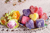 Colored soap in the form of heart on a white crocheted tablecloth — Stock Photo
