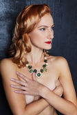 Young beautiful red-haired girl with chiseled cheekbones in designer jewelry — Stock Photo