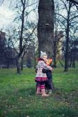 Little beautiful boy and girl in the autumn park — Stock Photo
