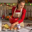 Happy young housewife making christmas cookies in kitchen — Stock Photo #59555709