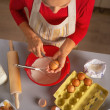 Young housewife making dough for christmas cookies — Stock Photo #59556173