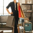 Full length portrait of happy young woman with shopping bags in  — Stock Photo #59636361