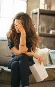 Frustrated young woman with letter in loft apartment — Foto de Stock