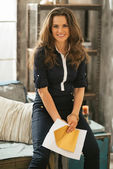 Portrait of happy young woman with letter in loft apartment — Photo