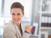 Happy business woman with eyeglasses in office — Stock Photo