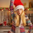 Happy teenager girl in santa hat having fun time in christmas de — Stock Photo #59903863