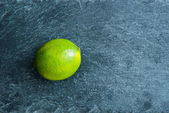Closeup on lime on stone substrate — Stock Photo
