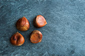 Closeup on chestnuts on stone substrate — Stock Photo
