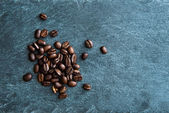 Closeup on coffee beans on stone substrate — Stock Photo