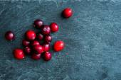Closeup on lingonberries on stone substrate — Stock Photo